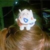 moonplanet: My Togepi beany plush sitting on my head. (togepi-on-my-head)