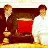 randomling: Sherlock and John (of BBC Sherlock) on a couch in Buckingham Palace, laughing. (sherlock/john)