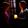randomling: Tara McLay holds a lit candle out to Willow Rosenberg. (Buffy the Vampire Slayer.) (tara/willow)