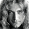 house_gembell: Black and white photo of a man in his 30s, with blonde curly hair. (Torrin)