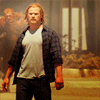 mjolnir_retriever: Thor in t-shirt and plaid and jeans, walking forward on a devastated street (showdown at the OK corral)