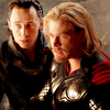 mjolnir_retriever: Loki whispering urgently in Thor's ear, while Thor stares furiously at a Jotun offscreen (brother and counselor)
