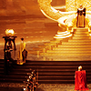 mjolnir_retriever: Thor and Loki kneeling before (and dwarfed by) the gold steps leading up to Odin's throne (brothers before Asgard's golden throne)