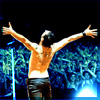 eleanorjane: Depeche Mode's Dave Gahan, onstage, head thrown back and arms wide to the crowd. (elation)