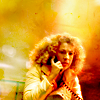 randomling: River Song (Doctor Who) holds a communicator to her ear. (river song communicator)