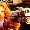 randomling: RIver Song (Doctor Who) holds a big gun in front of her. (river song big gun)