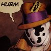 "sandoz_iscariot: Rorschach, a masked vigilante in a fedora, says ""HURM.""  His hat says ""MOD"" (Watchmen: MOD FEDORA)"