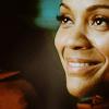 randomling: Uhura (Star Trek Reboot), grinning. (uhura)