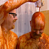 toft: adam pours sauce on jamie (mythbusters_tomato2)