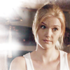 randomling: Audrey Parker (Haven) in a white vest, looking less than amused. (audrey)