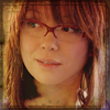 randomling: Toshiko Sato (Torchwood), wearing glasses, smirks. (tosh smirks)