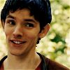 sophinisba: Merlin smiling with forest background (ep. 1.04) (merlin smiling by miakun)