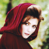 ar: A pale, dark-haired woman in a red hood. (pd - like little red riding hood)