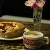 barefootsong: Table with teacup, scone, and flowers in vase. (teatime)