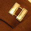 nightmachinery: An Army captain's insignia of two slightly tarnished silver bars, pinned to brown canvas cloth of a uniform shoulder. (Captain - Bars)
