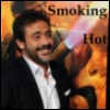 "jumpuphigh: JDM standing in front of a poster of The Comedian lighting his cigar with a flame-thrower. Text says, ""Smoking Hot."" (JDM Hot)"