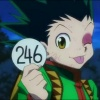 oneill: Hunter x Hunter - A battered Gon Freecss sticks his tongue out impishly as he holds up Ponzu's applicant tag (ごめんね)