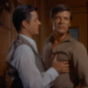 cowgirl65: Jarrod's hand is grasping Nick's chest, they both have an intense expression on their face (Nick & Jarrod)