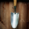 pinepigs_garden: Trowel against wood background (trowel)