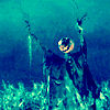 darchildre: a scarecrow with a pumpkin head, looking menacing (halloween)