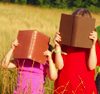 darchildre: children reading books in a field. (books are for adventure!)