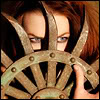 sporky_rat: A redheaded woman behind a spiked wheel (redheaded temper)