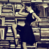 highlyeccentric: A woman in an A-line dress, balancing a book on her head, in front of bookshelves (Make reading sexy)