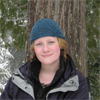 chemicallace: A cropped picture of me snowshoeing in the Twin Lakes area of the Cascade mountains, wearing a blue knitted hat I made. (Me in the Snow)