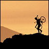 roadrunnertwice: Silhouette of a person carrying a bike up a hill (Bike - Carrying)