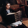 jalendavi_lady: Susan Pevensie reading a dictionary. (Susan with book)
