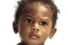 nike: A little girl raising her eyebrow. (eyebrow)