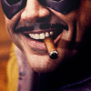 tomboy_typist: Image: Eddie Blake's cigar is darkly amused. (Watchmen:Comedian | Sadistic smile)