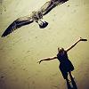 thegorgon: a girl facing a bird, wings spread, gold light (girl and bird)
