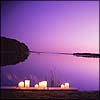 distractionary: candles in front of lake stretching to horizon (purple) (make sure I see white sails white sails)