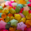 tehkittykat: lots of rainbow-colored star candies (fud; star candies)