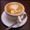 rhi: A cappucino, my name written in the froth. (cappucino)