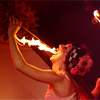 ccarlet: photo of contessa fire eating in her white corset and checkered headband ([misc] in the lamplight)