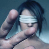 rising: a girl blindfolded and reaching out to touch what's in front of her (the cadre: touch)
