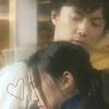 actiaslunaris: Galileo - Utsumi Kaoru resting her head on Yukawa Manabu's shoulder - text: a line-drawn heart (heart on his sleeve)