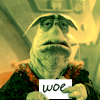kyriacarlisle: rygel holding a card reading WOE (didn't win the internet)