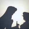 mikogalatea: Silhouette shot of Juri and Shiori from the Utena movie. Shiori is giving Juri her sword for a duel. (Juri/Shiori)