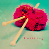 glinda: wooden needles in two bright red/pink balls of wool (knitting)