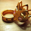princess: A gold ring in the shape of a crown. (princess ring)