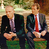 mrs_sweetpeach: Lewis and Hathaway sitting side-by-side on a park bench (Lewis/Hathaway on a park bench)