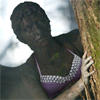 vicemage: A Weeping Angel statue from Doctor Who, peering around a tree, wearing a bikini top (Weeping Angel)