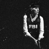 beatrice_otter: Black and white image of Emily Prentiss from Criminal Minds, with bulletproof vest and gun. (Emily Prentiss)