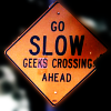 "sara_merry99: A sign reading ""Go Slow Geeks Crossing Ahead"" (Gen Geeks Crossing)"