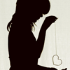 the_coffee_shop: The solid black silhouette of a girl holding a chain with a heart shape on the end of it. (rosemary)