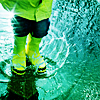 the_coffee_shop: A legs-only shot of someone wearing rain boots and standing in a puddle. (ray)