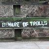 """healingmirth: spray paint stenciled on a bridge saying """"beware of trolls"""" (troll, trolls)"""